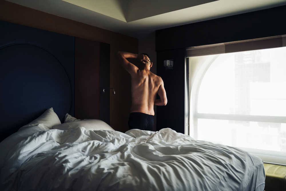 Man waking up from a bed