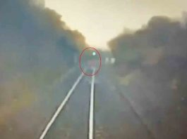 SHOCKING footage captures the moment unaware jogger runs across tracks, narrowly missing death -Viral Video News