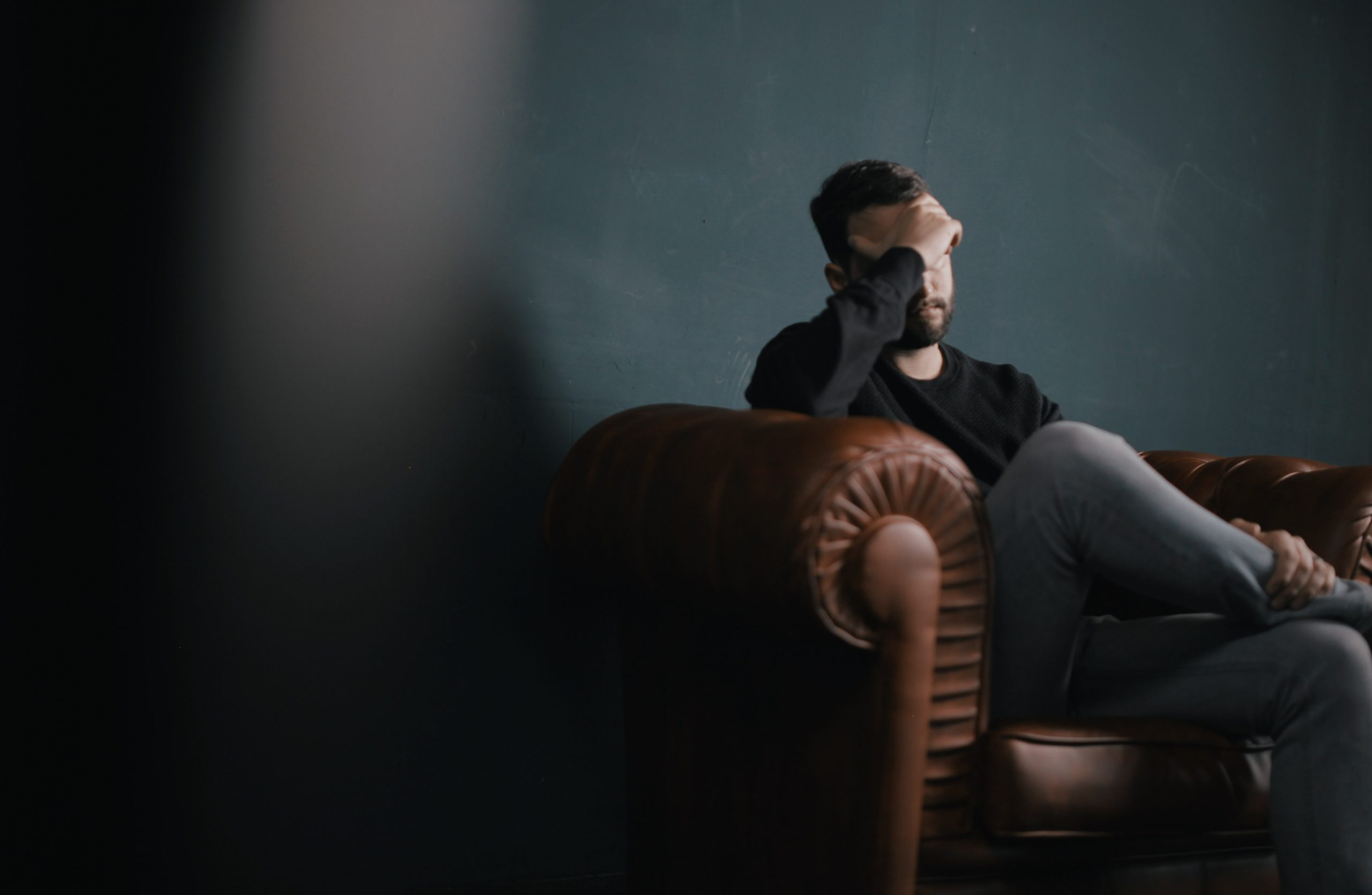Man on couch mental health struggle