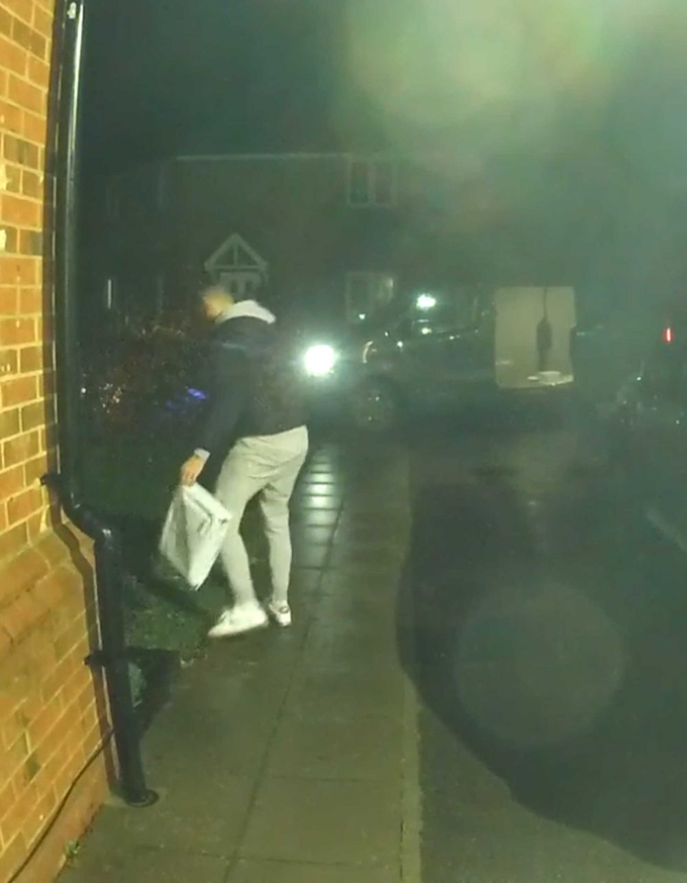 The courier walking away with the package - Viral News uk