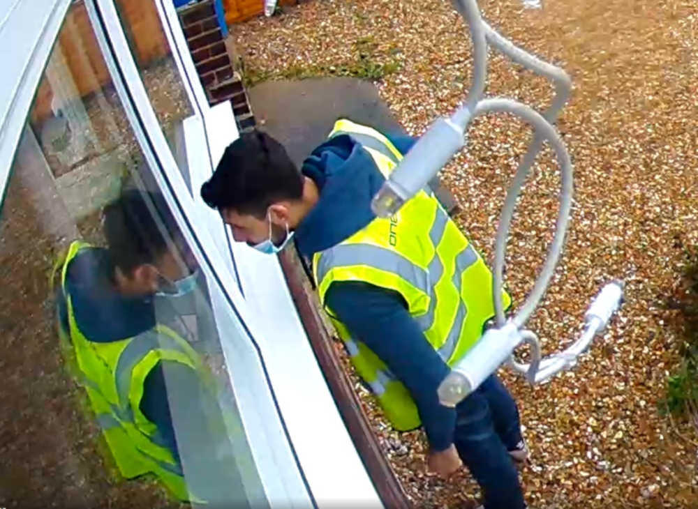 Amazon delivery driver caught breathign and writing on window