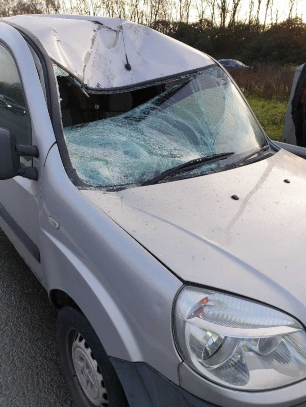 A silver van was crushed by a tyre from a lorry - UK News