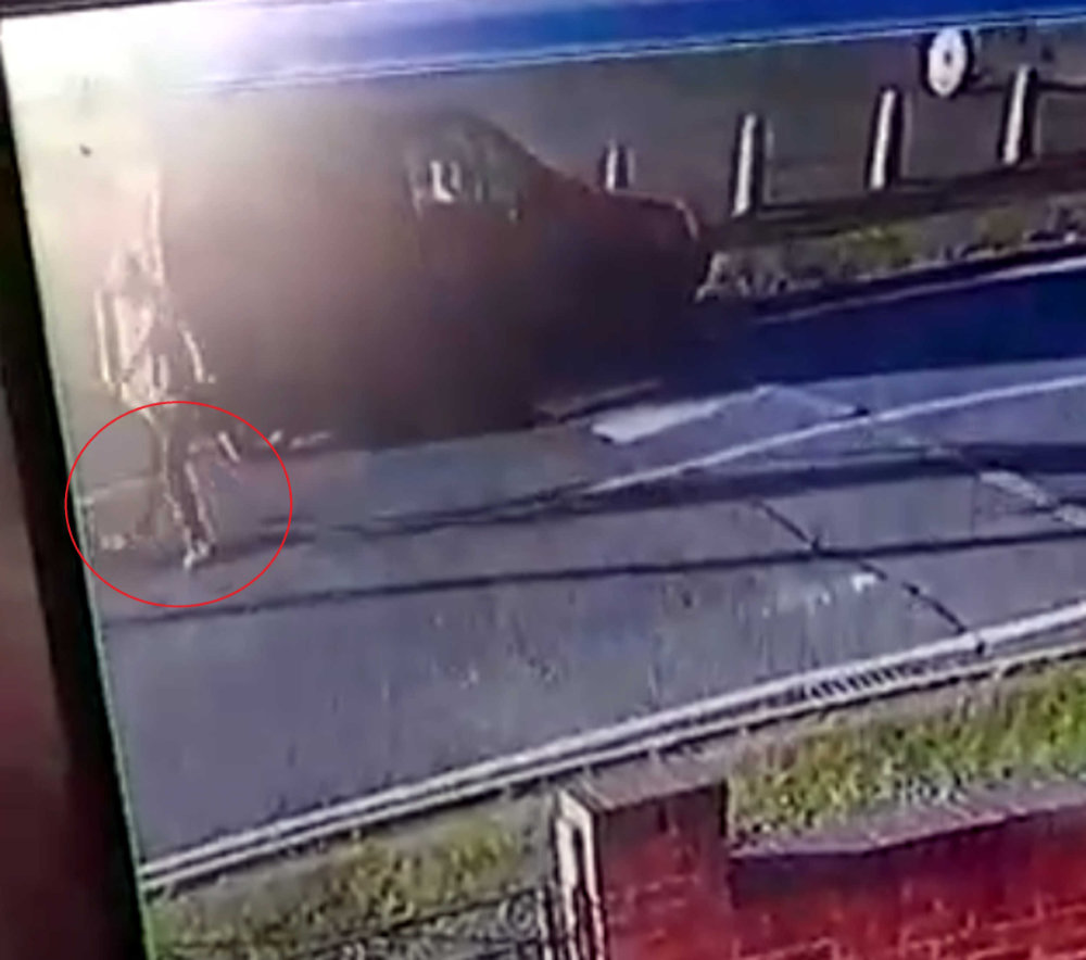 Amazon driver kicks parcel on road