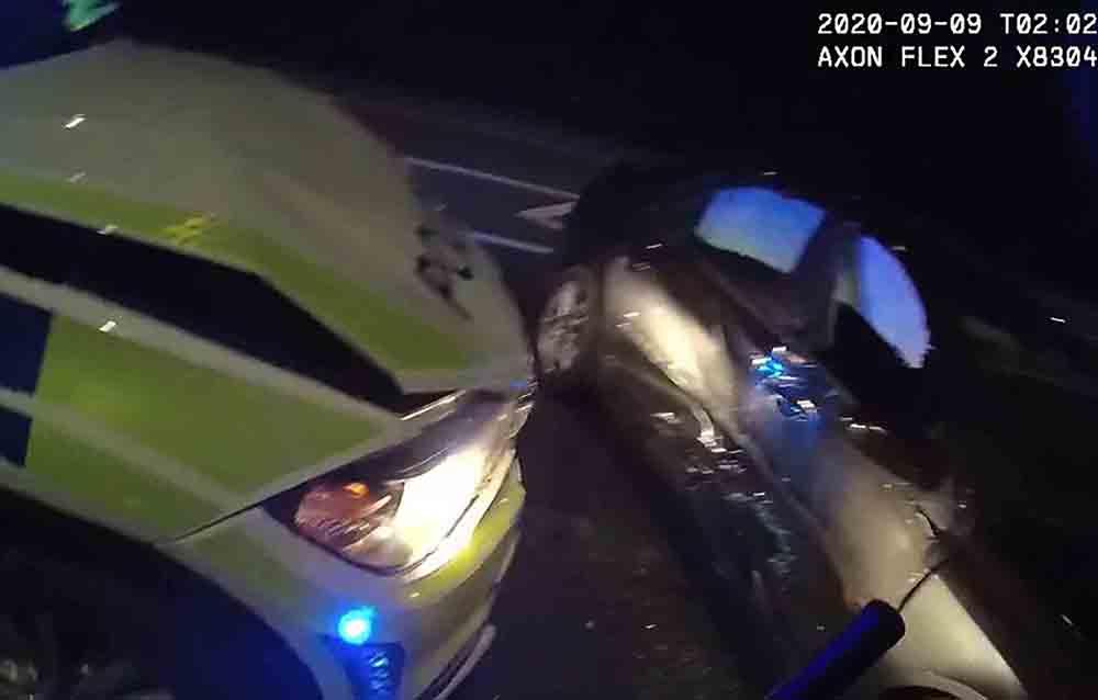 Shocking moment shows police smash into evading criminal using tactical stop - Crime News UK