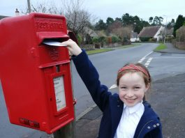 Murrin (Junior section) posting her card to Belhaven Care Home. Scottish News