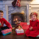 Children sat in front of a fire for Christmas- Business News Scotland