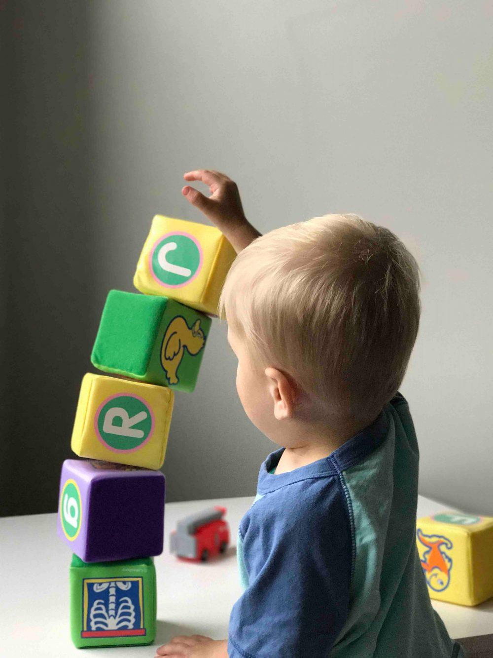 A child playing with blocks - Scottish News