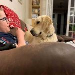 Young boy has assistance dog to help with disabilities -