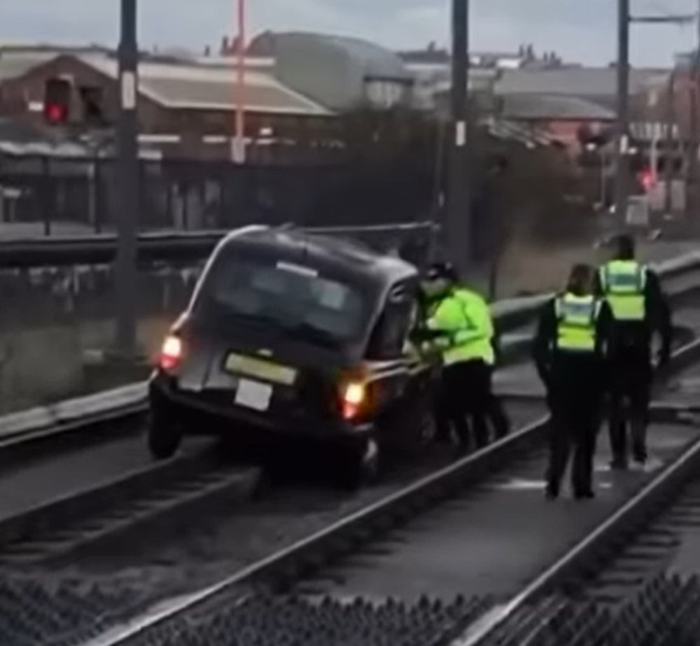 Taxi wedged between track stops tram service _ Viral Niws UK