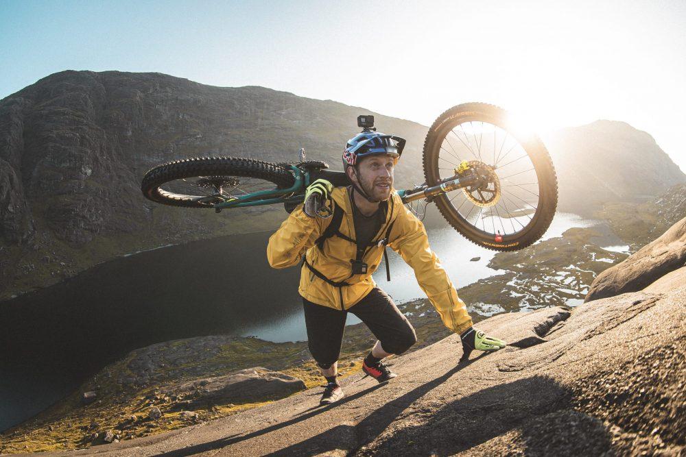 Danny MacAskill carrying his bike on the Dubh Slabs, Skye - Viral News Scotland