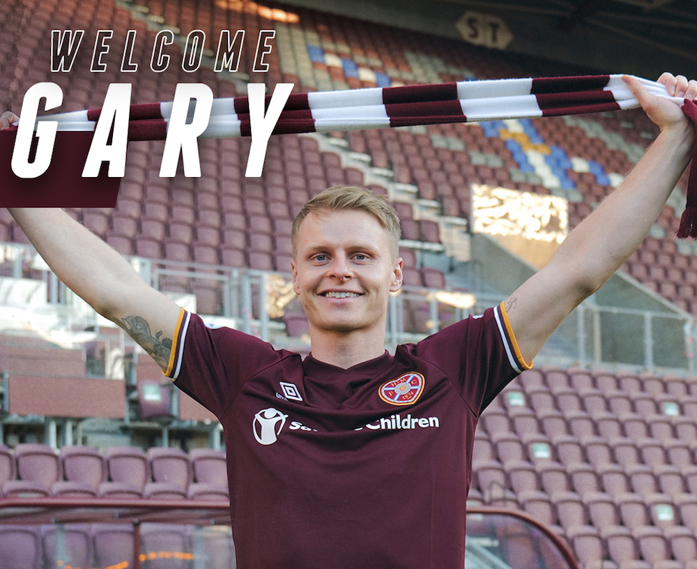 New Hearts signing Gary-Mackay-Steven holds scarf above head | Hearts news