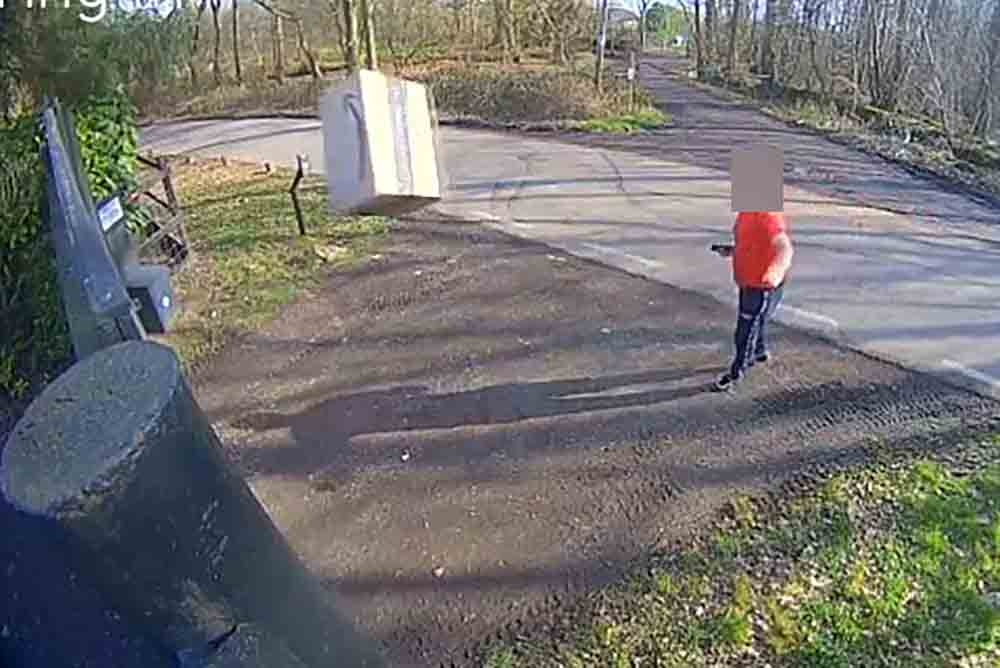 Incompetent amazon driver throws parcel at security gate - Video News UK