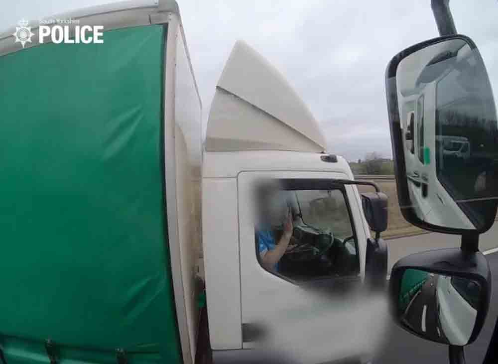 Shocking video shows HGV driver using two phones while driving - Police News UK