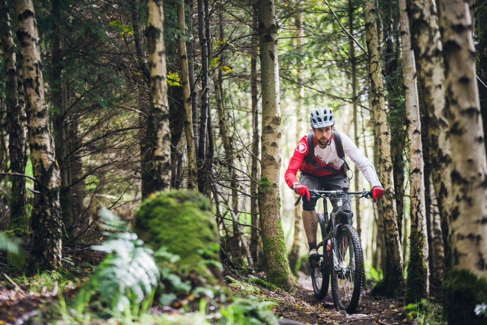 A person mountain biking - Business News Scotland