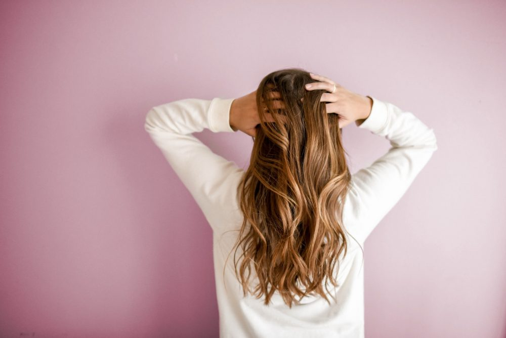 A woman touching her hair