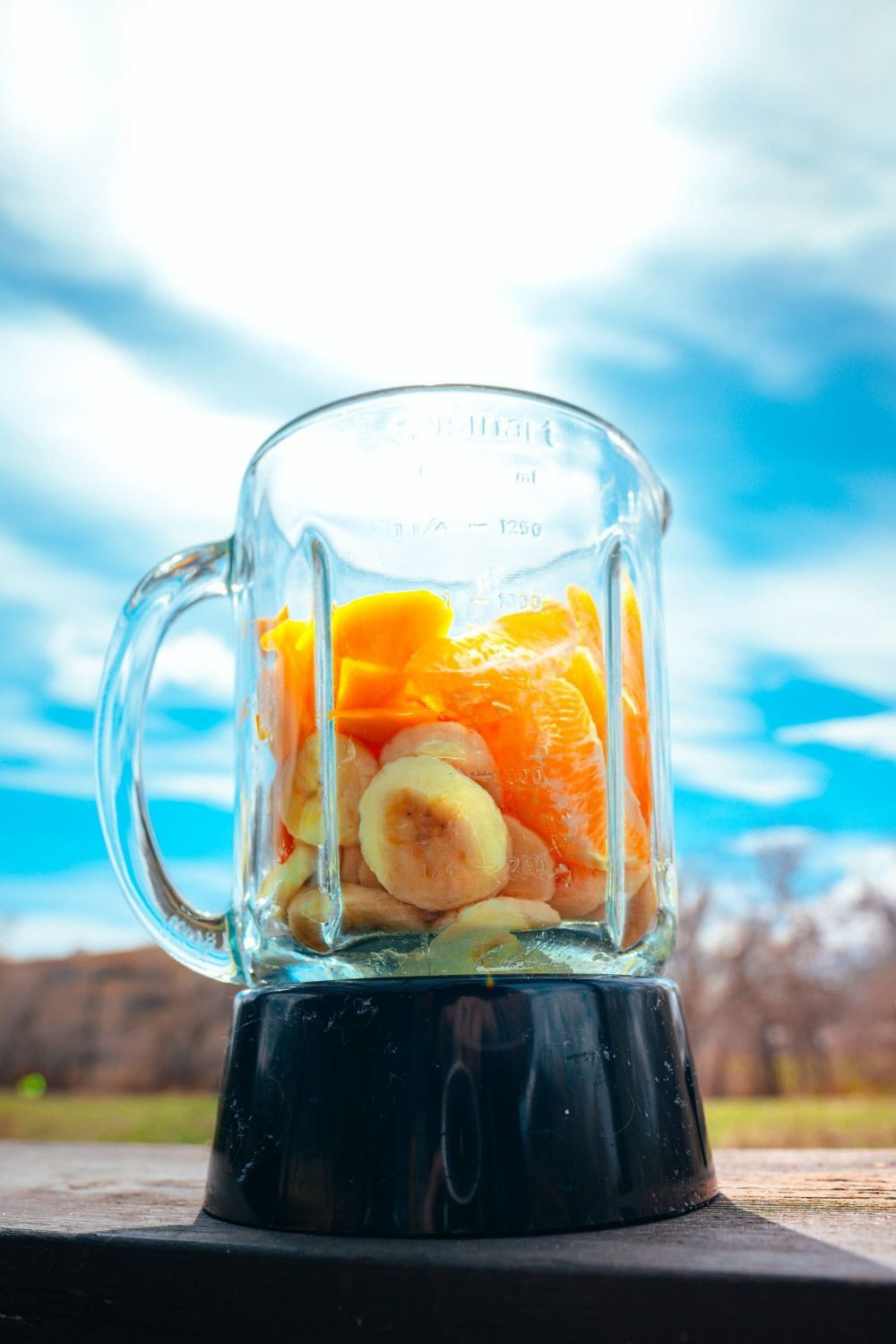 A blender with fruit in it