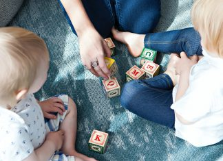 Children playing with letter blocks - Research News Scotland