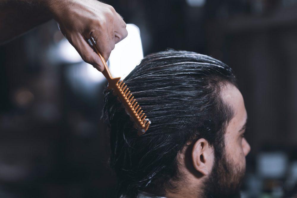 A man having his hair combed