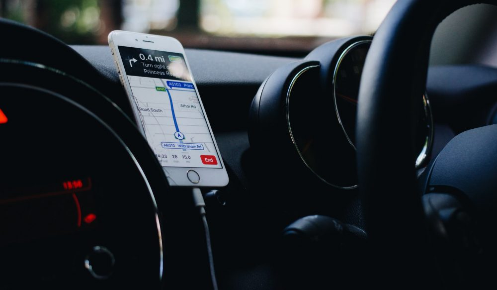 A phone on a car dashboard