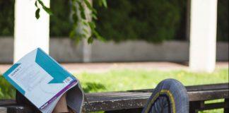 A person sleeping on a park bench - Health News Scotland