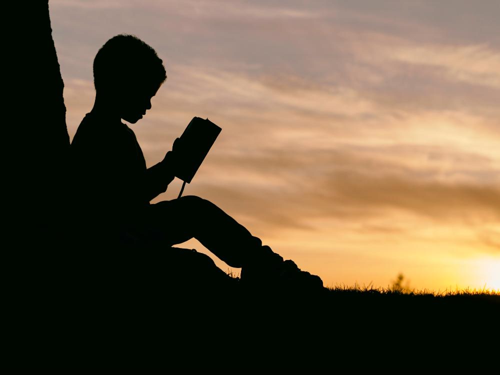 Child reading - Research News Scotland