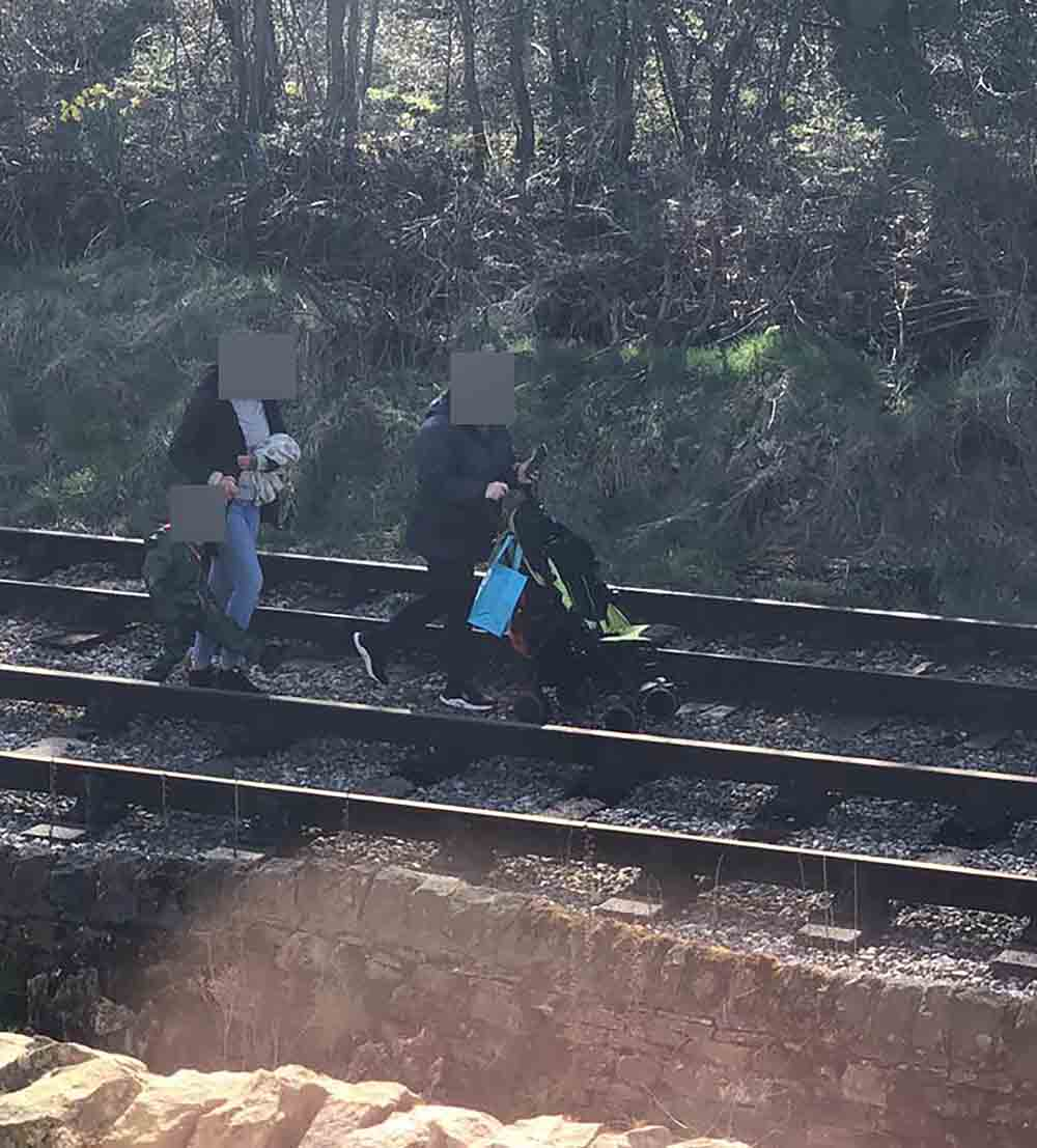Shocking images show family of adults and child walking on train track - UK News