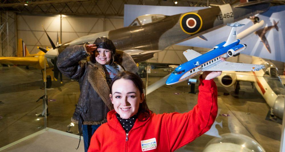 A women holding a lego plane - Scottish News