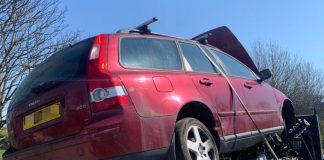 Car in flat-bed trailer | Travel News UK