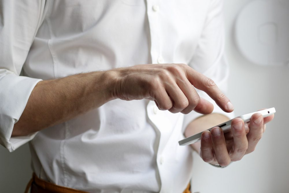 A man on a phone - Scottish News
