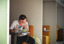 A man sat at a laptop looking stressed - Health News UK