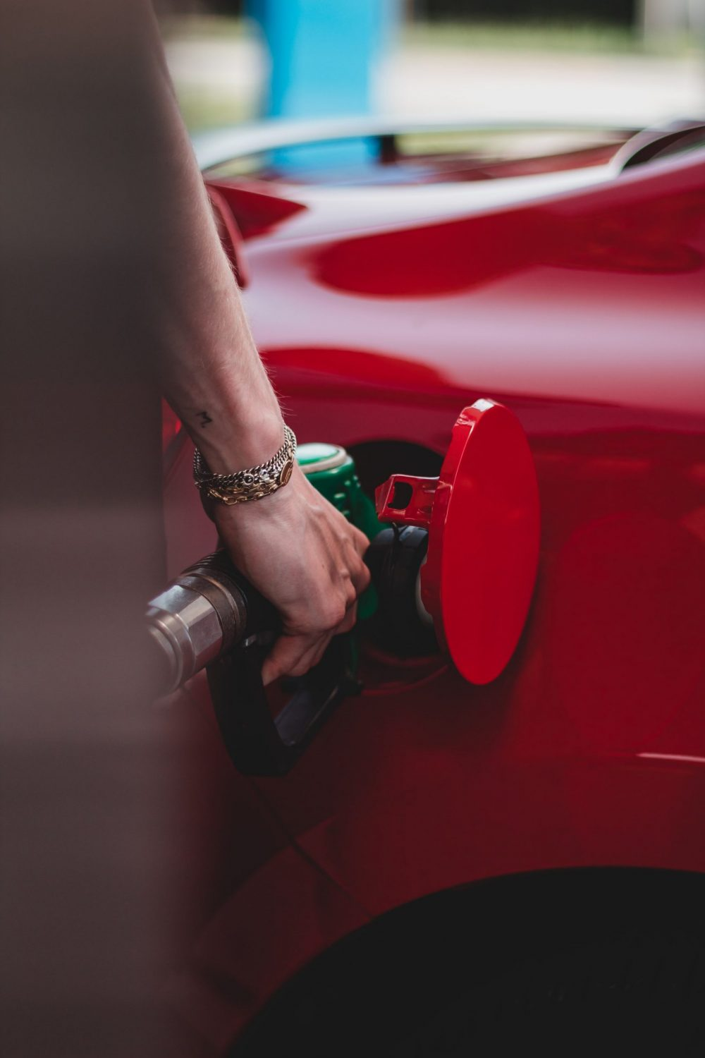 A person putting fuel into a car