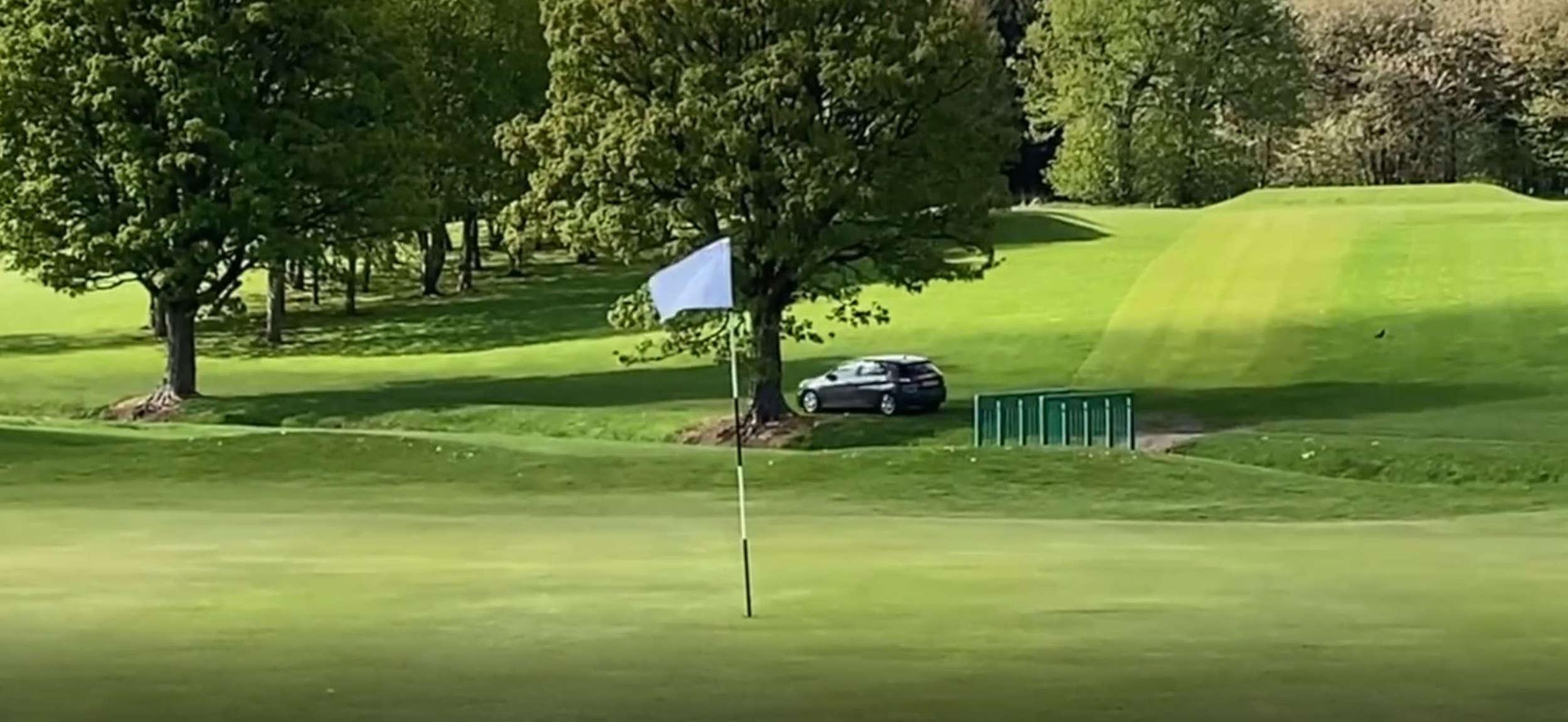 Car on Golf Course