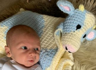 Baby Frederick with a knitted cow | Agriculture News UK