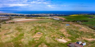 St Andrews, Scotland, UK. 28 April 2020. Aerial view of Feddinch Mains, a 240 acre site outside St Andrews in Fife, that has gone on the market. The land includes a partially built golf course and planning permission for a new 18 hole golf course and club - Business News Scotland