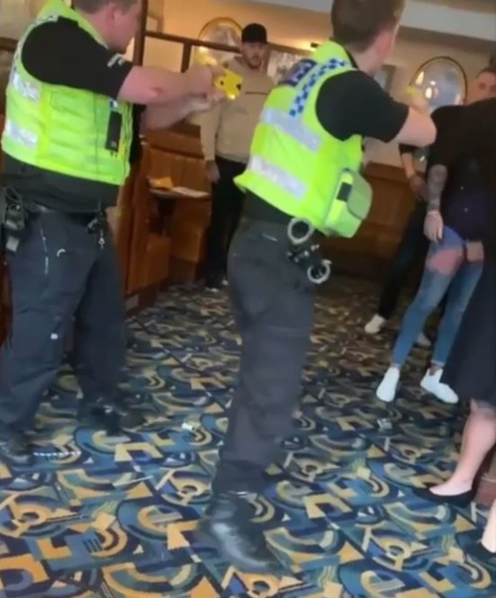 The police brandish tasers at the attackers - Police News UK