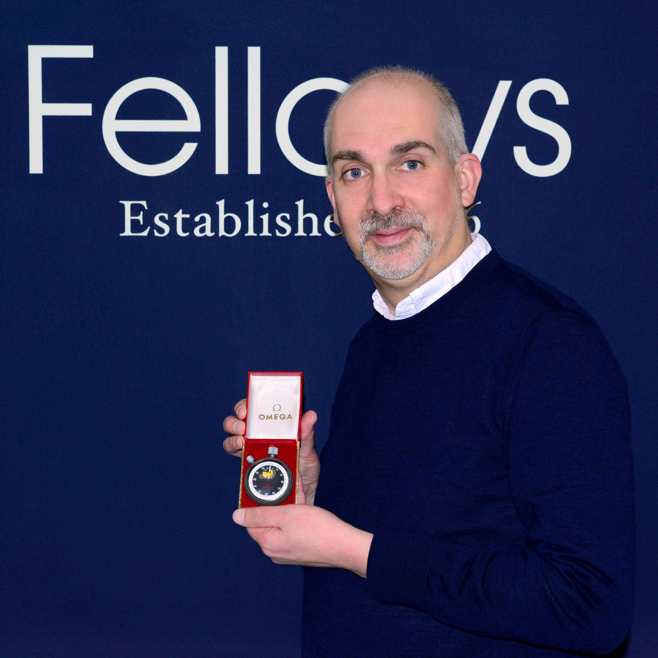 Steven Yambo with Jack Taylor Omega Stopwatch_Property of Fellows Auctioneers - Business News Scotland