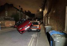Taxi that swerved to avoid cat ends up on top of car - Police News