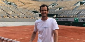 Andy Murray by a tennis court | Scottish Sports News