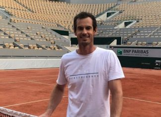 Andy Murray by a tennis court   Scottish Sports News