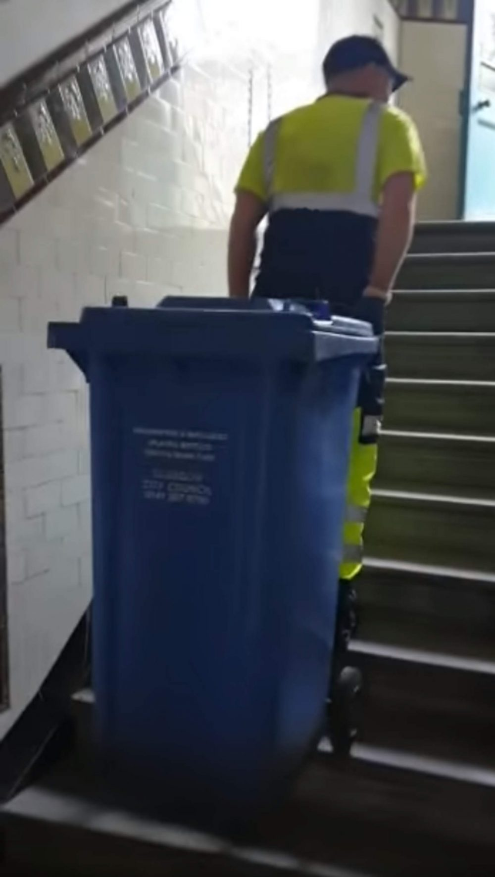 Chris Mitchell dragging bin upstairs - Scottish News