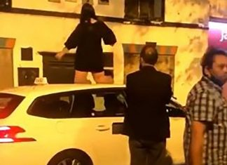 The woman gesturing on top of the taxi - UK News