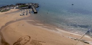 A Scottish festival has created a giant sand portrait to urge support for young musicians - Scottish News