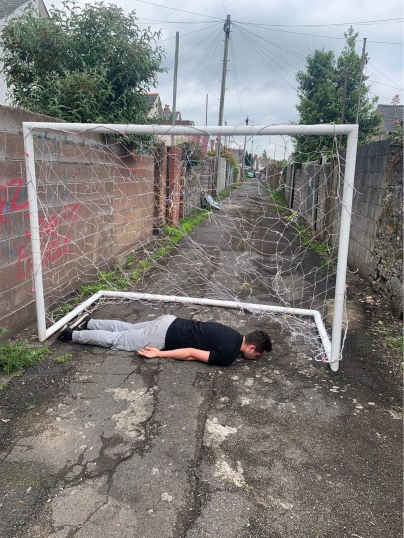 Owen Hopkins lying in goalposts- football news UK