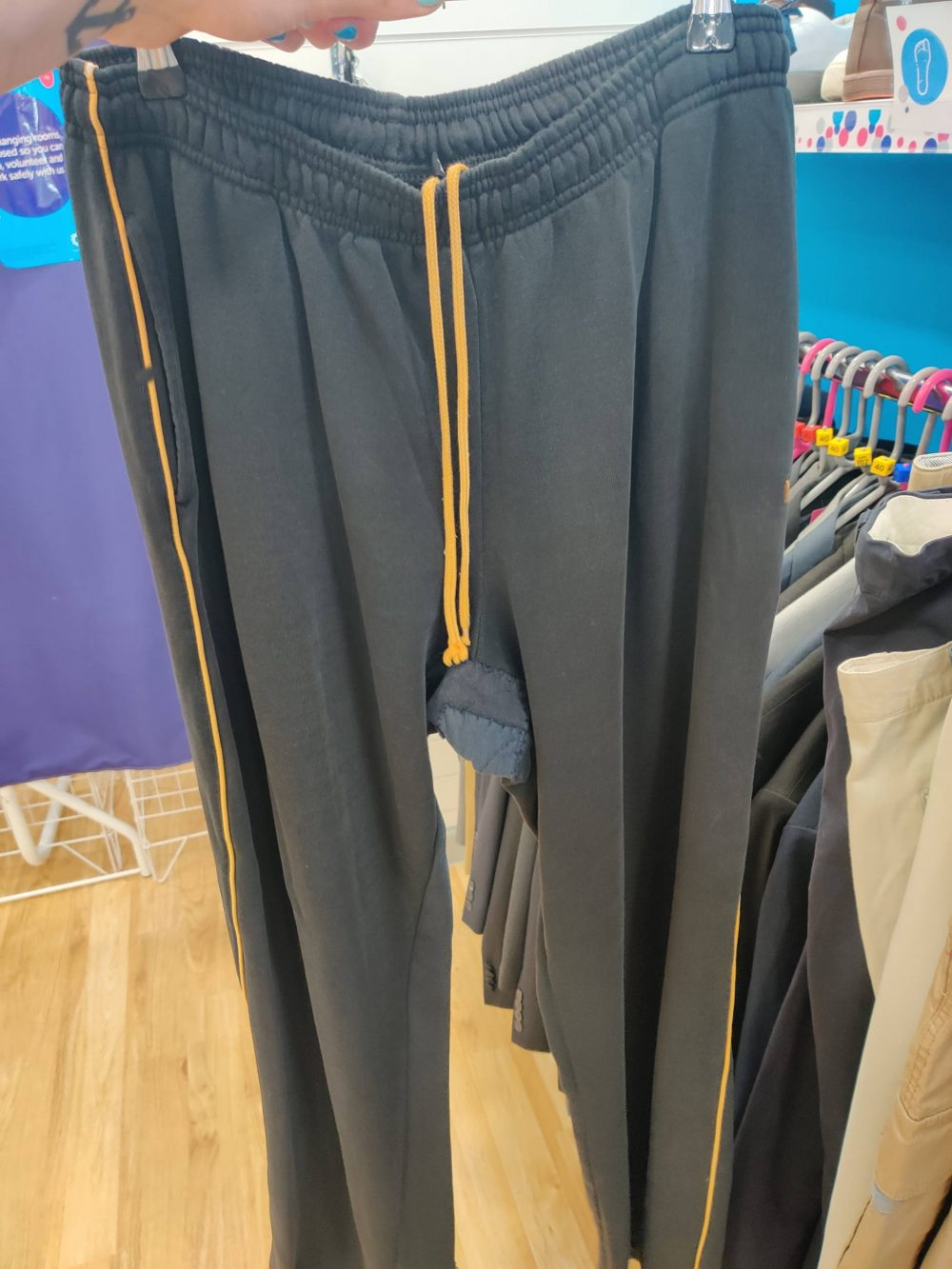 The patched dark grey tracksuit bottoms   Consumer News UK