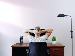 man relaxing at his desk at home  Business News UK