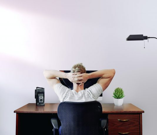man relaxing at his desk at home| Business News UK