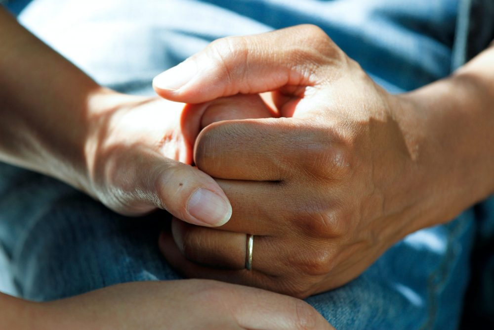 people holding hands in hospital| Research News UK