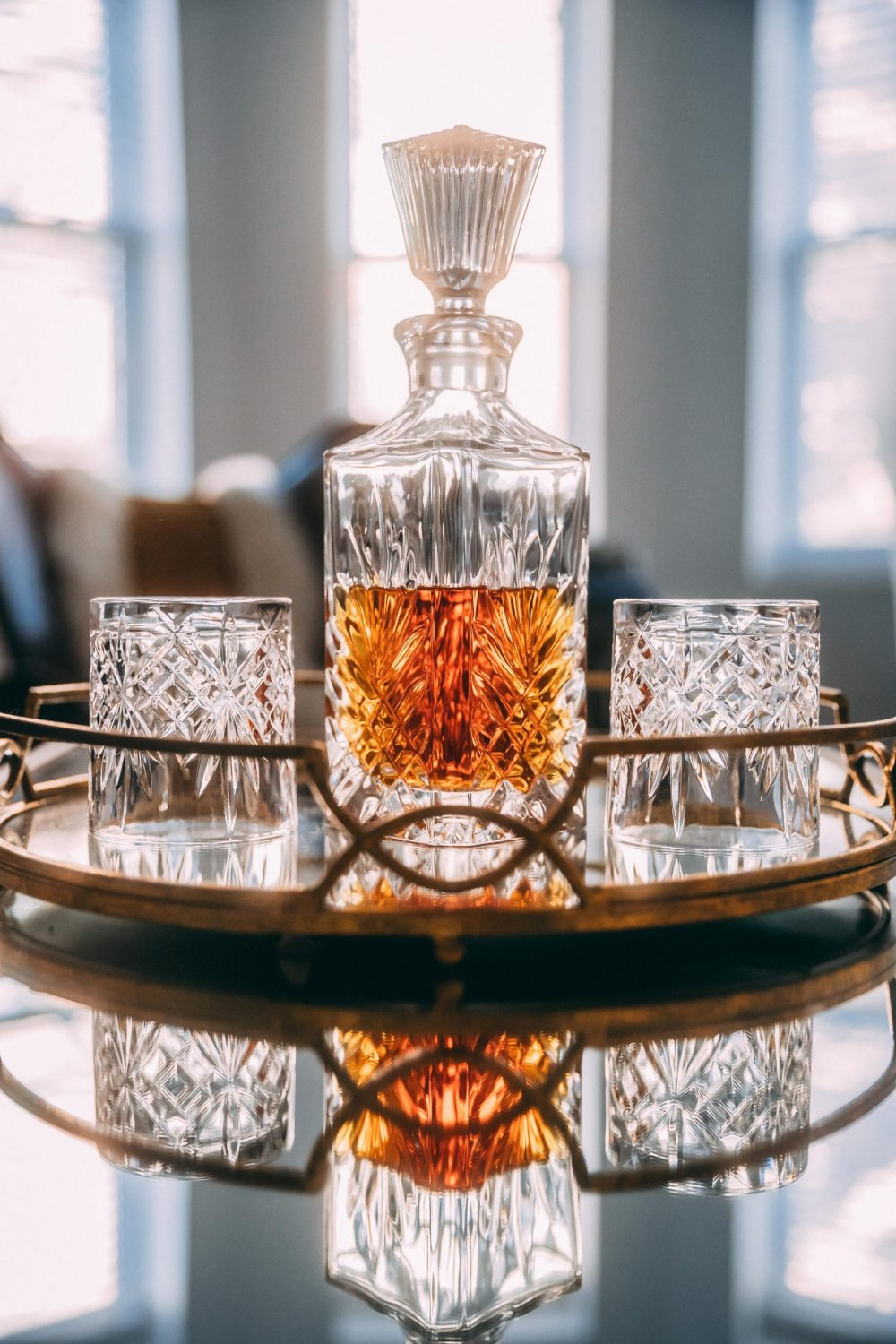 bottle and glasses of whiskey | Business News Scotland