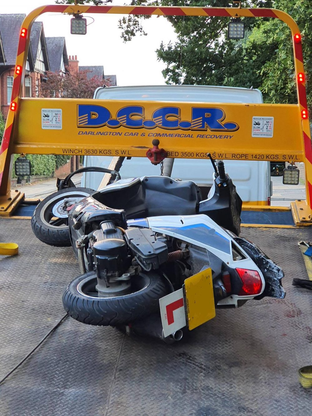 The seized moped on the recovery truck | Traffic News UK