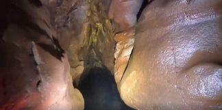 Kayaking through narrow cave - Watersports News Scotland